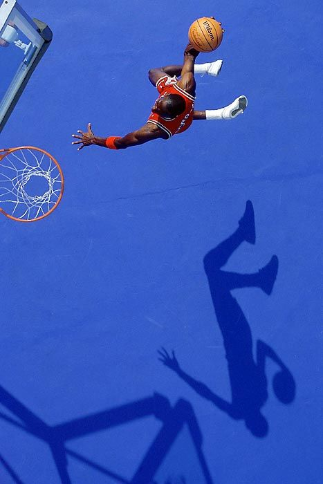 Jordan flies through the paint to the rim for a dunk in this 1987 action portrait.                                 %