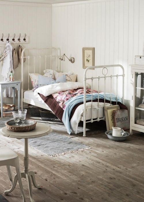 Metal bed frame in white and muted bedding