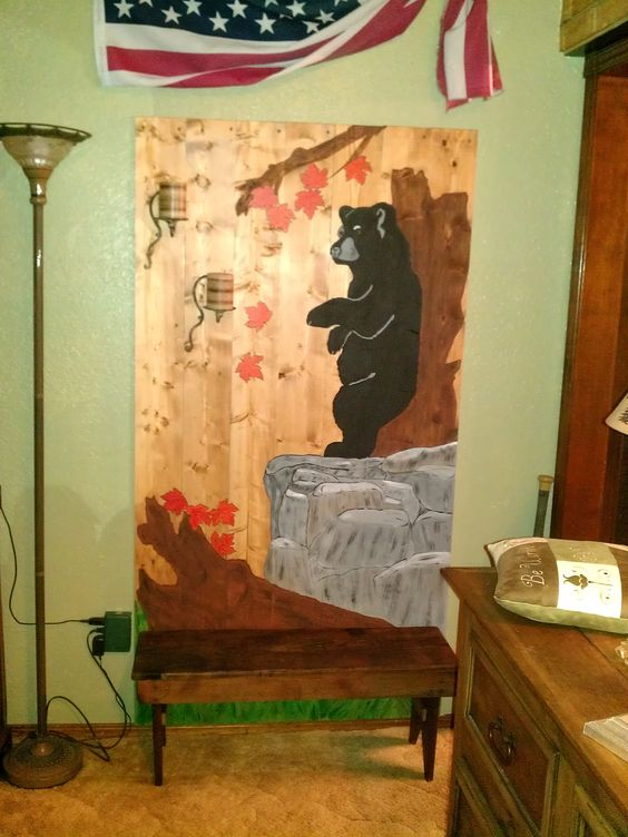 Hand painted bear scene on fence panels. Added 2 rustic candle holders and placed rustic bench in front.