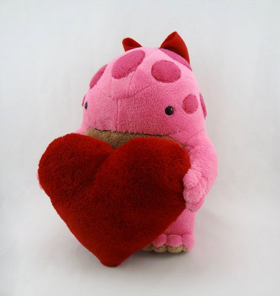 Pink quaggan holding heart