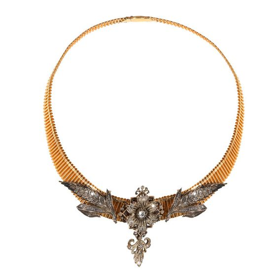 Late 19th Century Diamond Cluster Panels on a Gold Necklace, circa 1880. Designed as three floral elements to the front set with old-cut diamonds, the central cluster with figure of a flower with six petals suspending a small pendant, the side clusters in an ear of corn shape all on a 18Kt gold curb chain, the clusters close set in silver and gold. Via 1stdibs.