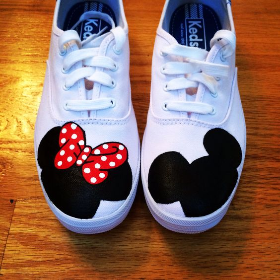 Minnie and Mickey Mouse heads painted on canvas sneakers.