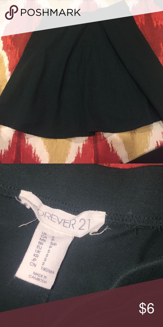 Forever 21 Forest Green Solid Color Skirt gently used- i dont think i've ever worn it. its a solid dark green color and can be very versatile when pairing it with a cute top. size S Forever 21 Skirts Mini