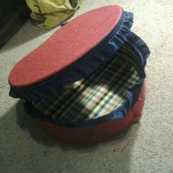 The first suitcase dog bed I made with red berlap and blue ribbon and the dog loves it