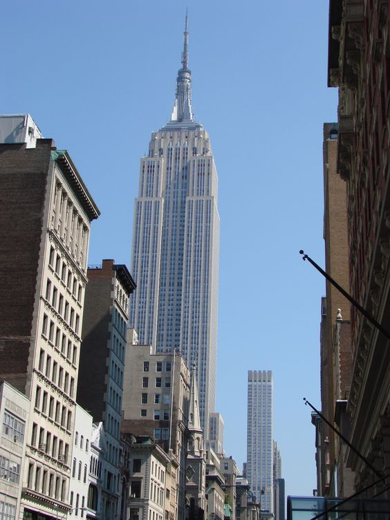 The Empire State Building from the sidewalk several blocks away.