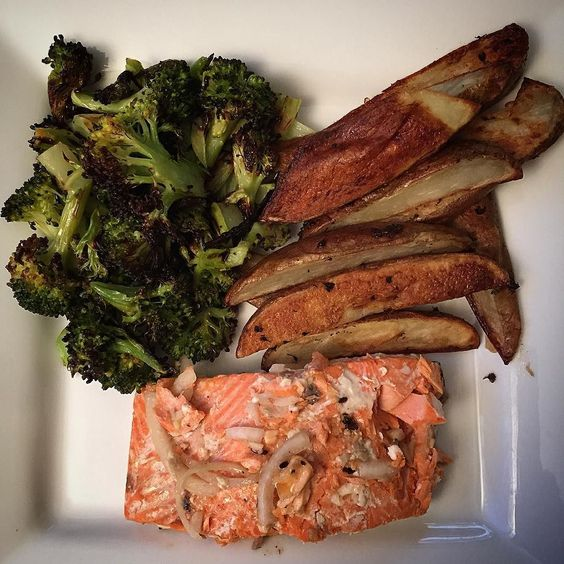 Wild sockeye salmon with roasted broccoli and oven baked potato wedges sprinkled with smoked sea salt. #foodie #cleaneating #bonappetit