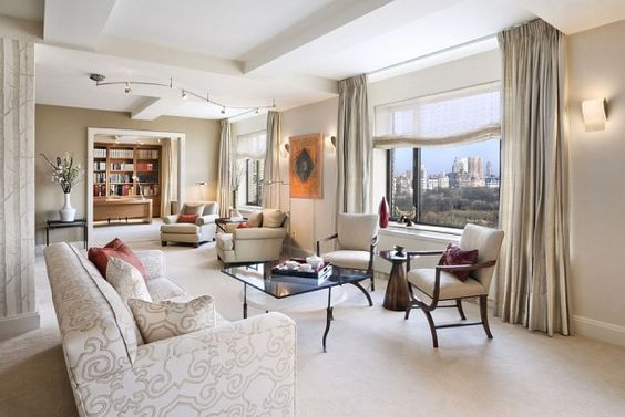 Some Inspiring Decoration Of Neutral Color For Your Home Interior Design: Beautiful Pattern Sofa And Pillow With Glass Table And Armchairs Facing To Wide Windows Glass With Curtain And Wall Sconces On The Side Overlooking The City View ~ Manningmarable