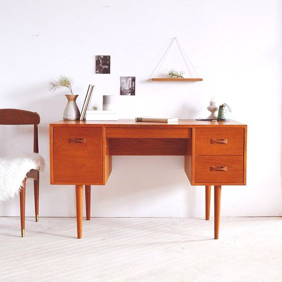 happy friday!  up for grabs - one vintage 1960's teak desk. 4 drawers for lots of storage. finished back so it can be placed in the middle of a room. dimensions are:  length: 48 inches height: 26 inches width: 24 inches email for price; viewing next week ↠