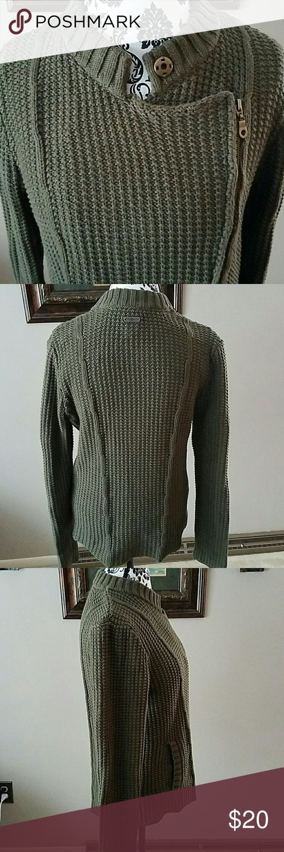 ASYMMETRIC ZIP SWEATER This is a great heavy knit sweater featuring: - exposed asymetric zipper - ribbed collar with optional snap to close - front pockets with ribbed trim - vertical side crocheted lines are slimming - 60% Cotton,  40% Acrylic - In EUC Ruff Hewn Sweaters Crew & Scoop Necks