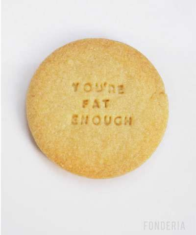 """These Diet Biscuits by Fonderia hope to help you stick to your diet. Each is printed with discouraging phrases like """"You're fat enough,"""" """"Hands off"""" and """"Eat me if you dare."""""""