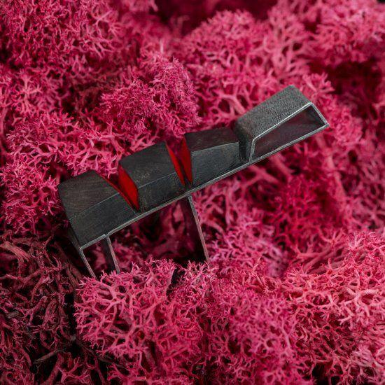 """Stenia Scarselli   """"TRAMPOLINO ROSSO""""-oxidized silver, piano keys in ebony, red two-component resin/ argento ossidato, tasti di pianoforte in ebano, resina bi-componente rossa 5 x 2,5 x 1,2 cm"""