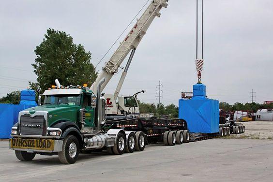 Mack Titan TriAxle pulling 3x3x3 beam trailer......
