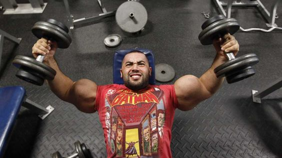 Body builder Moustafa Ismail lifts weights during his daily workout. Ismail has been given the title of world's biggest arms, biceps and triceps, by the Guinness Book of World Records. (AP Photo/Stephan Savoia)
