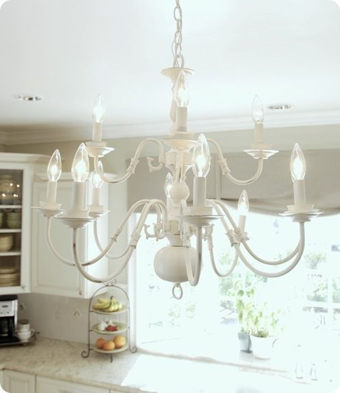 Brassy to Classy: My Free Chandelier: good tutorial, links to rewiring & painting a brass chandelier