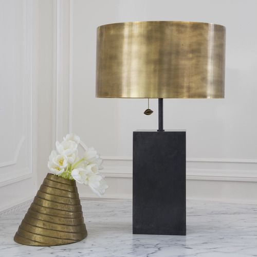 KELLY WEARSTLER | ZUMA TABLE LAMP. Mixed metals of bronze and antique burnished bronze, accented by Kelly's signature kiss motif in a thoughtful pull chain.