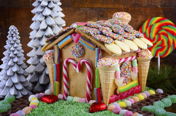 Adorable gingerbread house with ice cream cones, cookies for roof tiles, and pastels