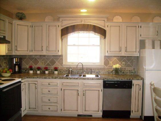 DIY antiqued cabinets, faux tile backsplash, faux marble countertop.....$17.00 kitchen redo!!