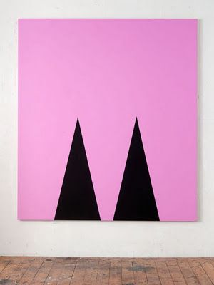 big abstract statement canvas piece in neon pink with two black triangles