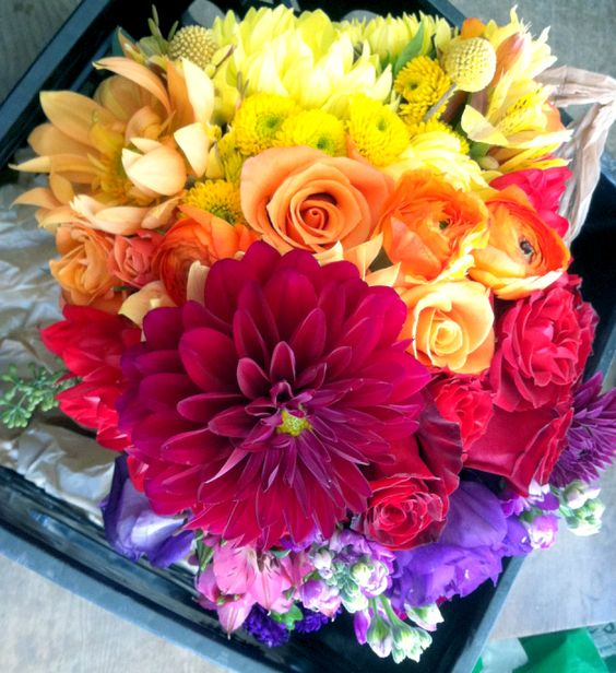 A brilliant bridal bouquet color fade from yellow to purple - a stunning array of flowers & color! www.fioreofpensacola.com