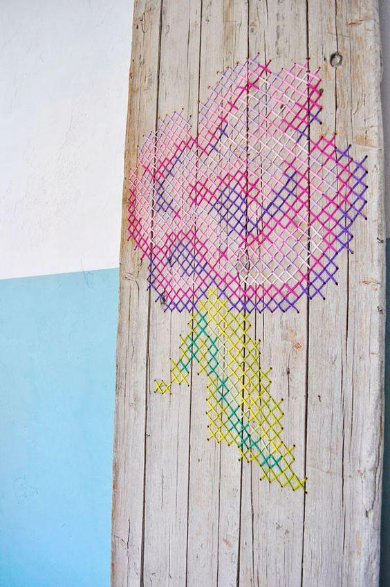 Cross stitch flower on wood: