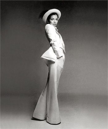 Wedding dress 70s style - Bianca Jagger The White Pantsuit That Defined Them All