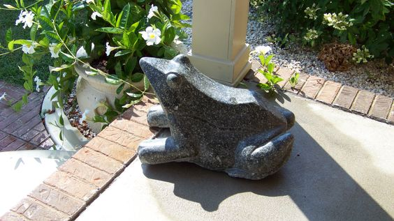Stone Frog hand-crafted from granite. Take a look at http://www.stonestatuestore.com/natural-stone-granite-animals