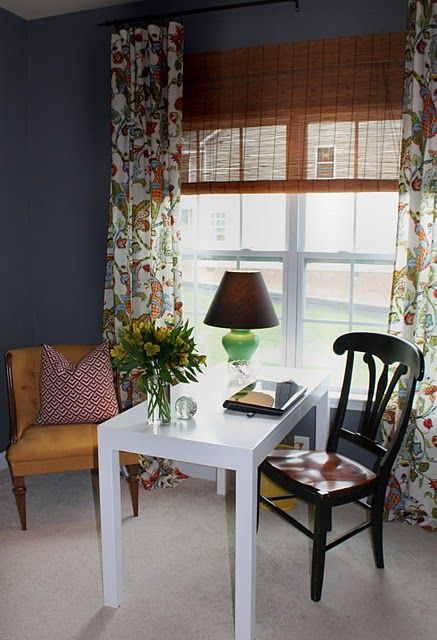 In love with the neutral gray and the colorful curtains.