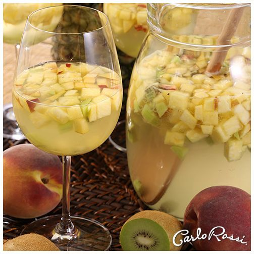 By the small pitcher: 2 cups Carlo Rossi Moscato Sangria, ½ cup coconut rum, 1 cup coconut water ¼ cup lime juice, 1 cup pineapple chunks (cut into small diced cubes), 3 kiwis (cut into small diced cubes), 1 mango or peach (cut into small diced cubes), 1 cup lemon-lime soda or seltzer. Combine first seven ingredients and chill overnight or up to two days ahead. Add soda before serving. Serves 4. To make a large pitcher, double recipe to serve 8.