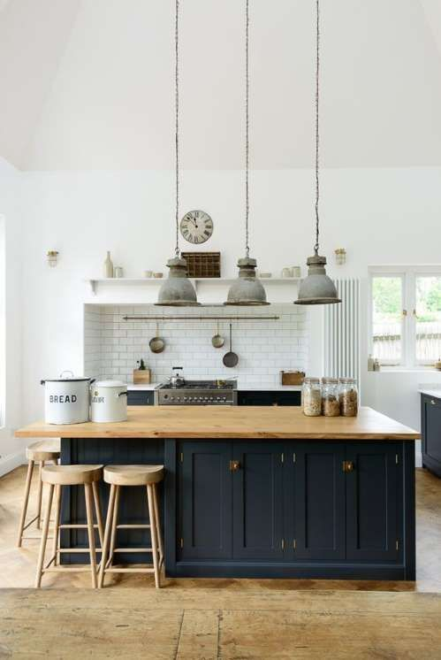 Modern farmhouse kitchen with navy cabinets, vintage zinc pendant lights, and clean airy high ceilings. #kitchendesign #kitchendecor #modernfarmhouse #moderncountry #homedecor #farmhousedecor