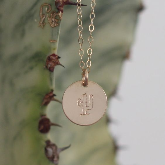 Dainty gold and prickle-free, this cactus necklace is perfect for those who love the southwest. Each necklace is hand-stamped with a cute…