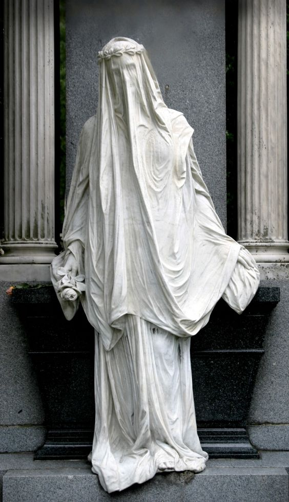 Beautiful veiled mausoleum statue
