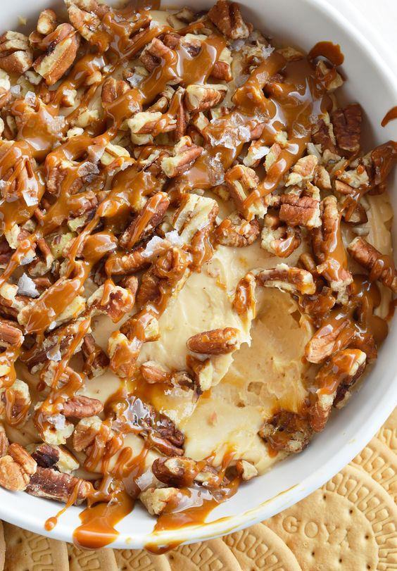 If you need a last minute dessert recipe that is sure to be a hit this Salted Caramel Pecan Cheesecake Dip is it! Caramel marshmallow fluff cream cheese filling is topped with pecans, caramel and flaked salt. This dessert dip is so tasty and only takes 5 minutes to make!!