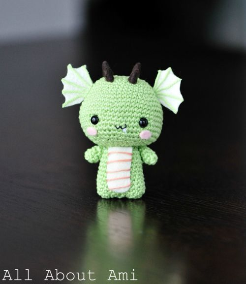 a small green crochet amigurumi dragon....now I just need to learn how to crochet