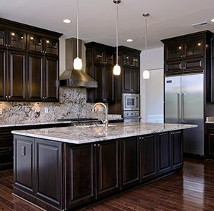 Dark wood works really well with a lighter piece of granite countertop. Not to mention the continuation all the way up the wall makes it super stylish and a great look for any home.