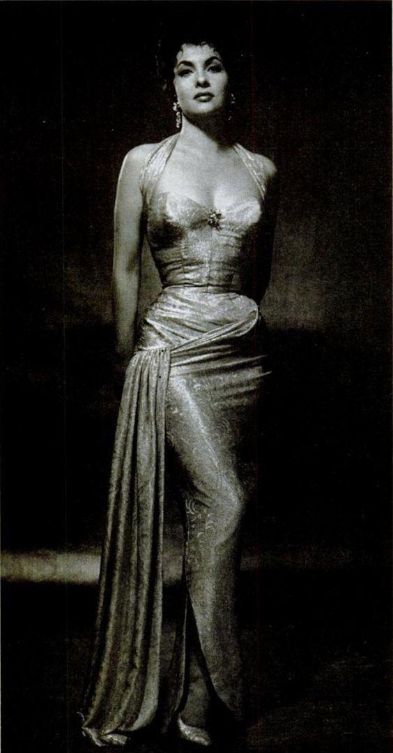 Gina Lollobrigida in a stunning brocade halter wiggle dress (1954).