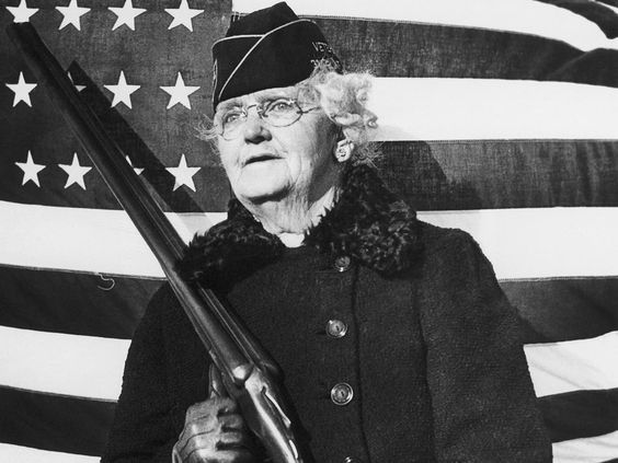 """Mrs. Paul Titus, 77-year-old air raid spotter of Bucks County, Pennsylvania, carries a gun as she patrols her beat, on December 20, 1941. Mrs. Titus signed-up the day after the Pearl Harbor attack. """"I can carry a gun any time they want me to,"""" she declared. (AP Photo)In Focus - World War II: Women at War - The Atlantic"""