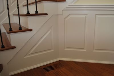 Love this wainscoting for the stairs.