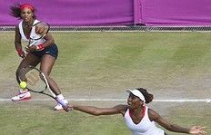 Serena Williams (L) and Venus Williams of the US returns the ball to Italian Sara Errani and Roberta Vinci during their women's doubles tennis match Quarter Final at the London 2012 Olympic Games in London on August 2, 2012. The Williams' won 6-1, 6-1.