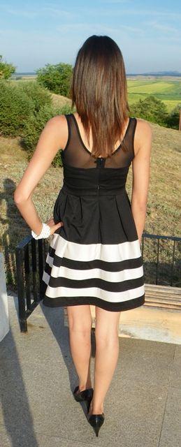 The back side of Black Sexy Sheer Gauze Panel Sleeveless Dress with Stripes Hemline