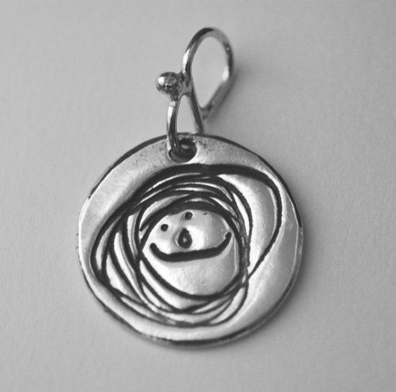 Doodle Tag.  Upload your child's artwork and have it made into a recycled silver pendant!  Plus, you get a rubber stamp and stamp pad with your child's doodle!  COOL!