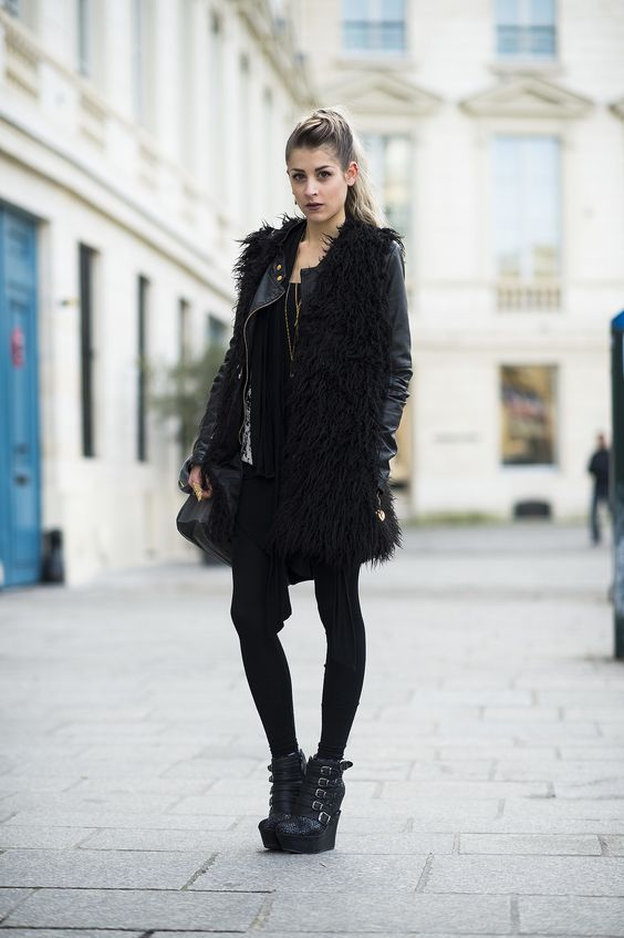 A rocker girl through and through, from her furry vest to her extreme buckled wedges. Source: Le 21ème | Adam Katz Sinding
