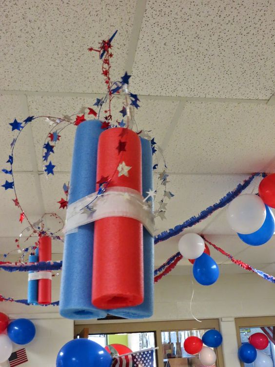 4th of July party ideas - pool noodles wrapped with crepe paper and garland coming out the top!