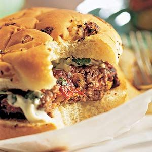 Dried Tomato Burgers Recipe:   This grilled burger recipe is for grown-ups who appreciate a bite of jalapeno, dried tomatoes, and lime peel in burgers. Stacked on buns, the burgers are topped with spicy mayo and fresh greens.