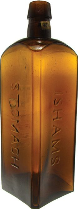 Ishams Stomach Bitters, Tobacco Amber. An Ishams Stomach Bitters glass bitters bottle in tobacco amber with applied top