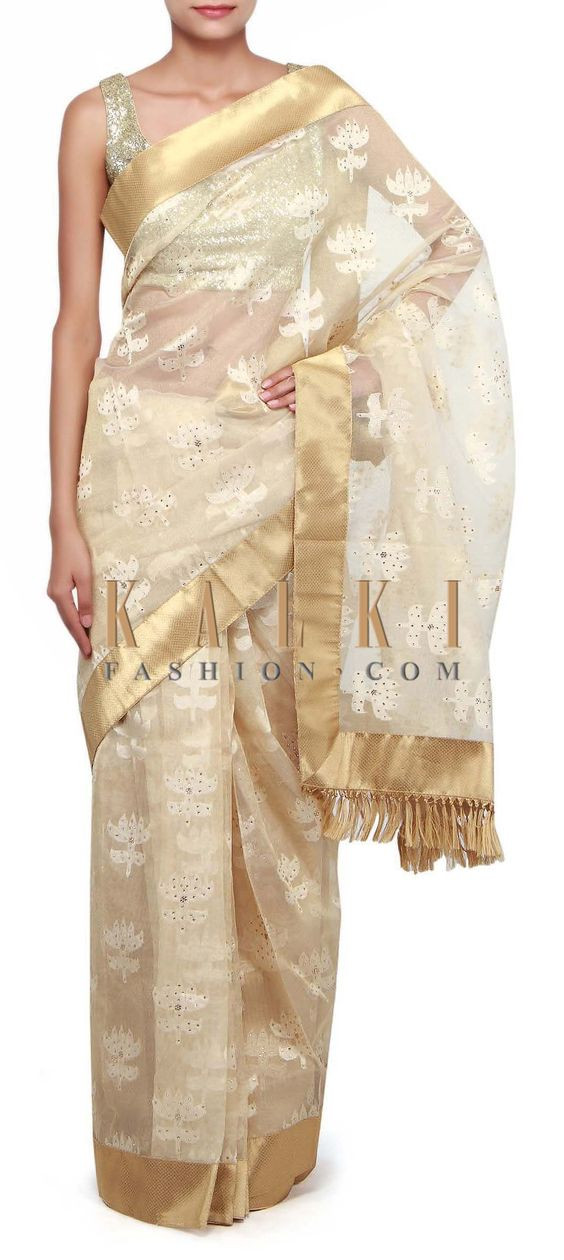 Buy Online from the link below. We ship worldwide (Free Shipping over US$100). Product SKU - 260739. Product Link - http://www.kalkifashion.com/gold-saree-adorn-in-weave-and-kundan-work-only-on-kalki.html