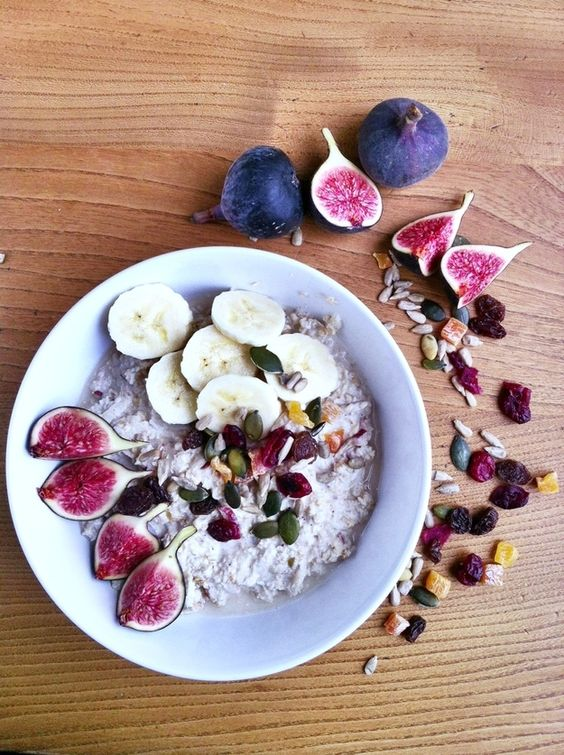 Overnight Bircher Muesli with figs, banana, coconut, cinnamon, mixed berries and seeds