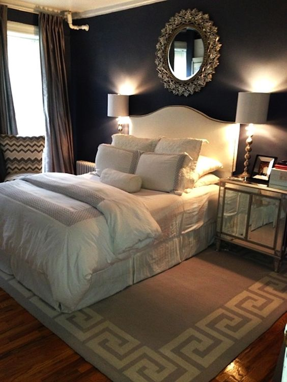 I like this room because the black wall color. which is main focal point. white silk bed spread is making room elegant.room has element of line, shape ,color ,space, pattern, texture.lamps on wall are making wall dramatic.silk drapery and bed cover creating elegance .round mirror creating softness in the room.