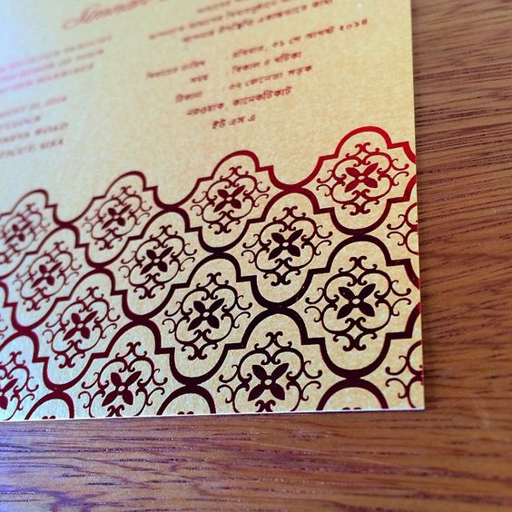 This sophisticated #Indianweddingcard is a digital print with #foil on a gold paper. The red is a bold look that is sensational.
