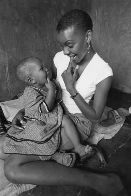 Photo - AIDS PATIENT, BOTSWANA. Gabane village, near Gaborone. Mpule Kwelagobe, Miss Universe 1999 with Dipu - Hard Rain Picture Library
