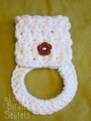 Use any towel besides grandmas with the crochet connection. Little Birdie Secrets: crocheted towel holder pattern (or buy at her Etsy shop)